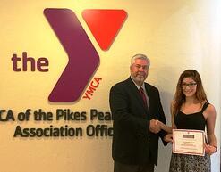 Kaylee Marquez recieves the 2014 YMCA James D. Berwick Scholarship